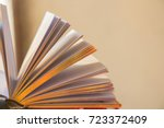 open book with golden pages  in ... | Shutterstock . vector #723372409