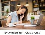portrait of pretty woman... | Shutterstock . vector #723387268