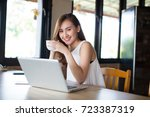 portrait of young woman... | Shutterstock . vector #723387319