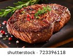piece of roast beef with spices ... | Shutterstock . vector #723396118