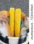 two huge boiled cobs of corn... | Shutterstock . vector #723414064