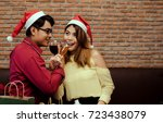 young man and woman couple... | Shutterstock . vector #723438079