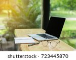 wooden table with laptop ... | Shutterstock . vector #723445870
