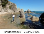 girl  the sea and the rocks.... | Shutterstock . vector #723473428
