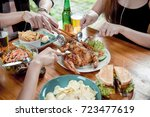 peoples are eating grilled... | Shutterstock . vector #723477619