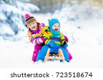 little girl and boy enjoy a... | Shutterstock . vector #723518674