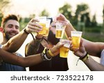 group of friends drinking beers ... | Shutterstock . vector #723522178