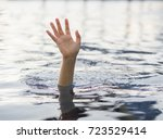 Small photo of Drowning victims, Hand of drowning woman needing help. Failure and rescue concept.
