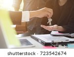 estate agent giving house keys... | Shutterstock . vector #723542674
