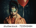 sinister clown man stained in... | Shutterstock . vector #723543484