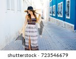 charming woman in old streets... | Shutterstock . vector #723546679