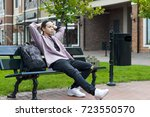 young man is resting sitting on ... | Shutterstock . vector #723550570