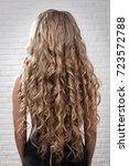 hair wavy curls on the model of ... | Shutterstock . vector #723572788