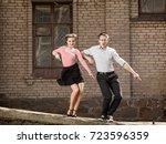 Young Couple Dancing Swing...