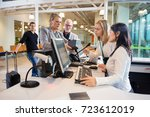 businesswoman looking at staff...   Shutterstock . vector #723612019