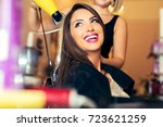 woman getting her hair dried at ... | Shutterstock . vector #723621259
