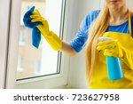 young woman in yellow gloves...   Shutterstock . vector #723627958