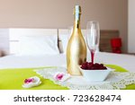 bottle of wine and a cup of... | Shutterstock . vector #723628474