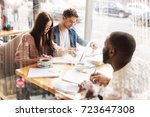 concentrated colleagues working ... | Shutterstock . vector #723647308