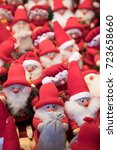 Small photo of TALLINN, ESTONIA - DECEMBER 07, 2016: Red colored Christmas elf decorations with soft-focus background for sale at Christmas market stall in the Old Town of Tallinn, Estonia on December 07, 2016