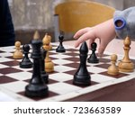 a child plays chess | Shutterstock . vector #723663589