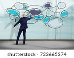 Small photo of View of a Businessman in front of a wall writing on a business chart organization - Business concept