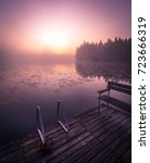 misty autumn morning at the lake | Shutterstock . vector #723666319