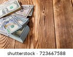 money isolated on a wooden... | Shutterstock . vector #723667588