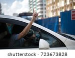 driver in a white car with... | Shutterstock . vector #723673828