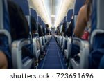 Passengers traveling by a modern commercial plane, shot from the inside of an airplane - stock photo