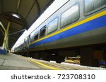 train arriving at train station | Shutterstock . vector #723708310