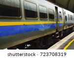 train arriving at train station | Shutterstock . vector #723708319