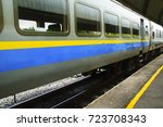 train arriving at train station | Shutterstock . vector #723708343