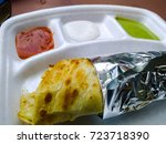kathi roll on plate with sauces | Shutterstock . vector #723718390