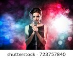 Young Woman With Microphone And ...