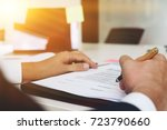young businessman holding a pen ... | Shutterstock . vector #723790660
