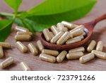 herbal medicine on wood spool... | Shutterstock . vector #723791266