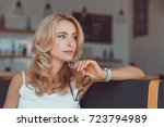 beautiful pensive middle aged... | Shutterstock . vector #723794989