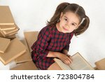 the girl the schoolgirl sits... | Shutterstock . vector #723804784