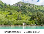 scattered spruce trees dot the... | Shutterstock . vector #723811510