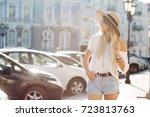 happy charming girl dressed in... | Shutterstock . vector #723813763