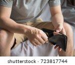 sad man looking at his wallet... | Shutterstock . vector #723817744