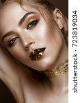 beautiful girl with a golden... | Shutterstock . vector #723819034
