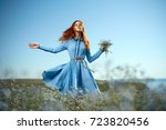 woman with a bouquet of wild... | Shutterstock . vector #723820456