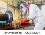 worker arc welder steel piping... | Shutterstock . vector #723838234
