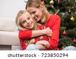 happy mother and daughter... | Shutterstock . vector #723850294