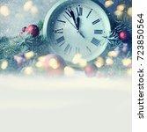 christmas clock and fir... | Shutterstock . vector #723850564