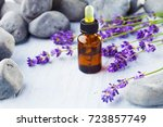 bottle of lavender massage oil  ... | Shutterstock . vector #723857749