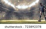 soccer player kicks the ball on ... | Shutterstock . vector #723892378