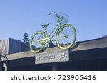 a green bike mounted on top of... | Shutterstock . vector #723905416